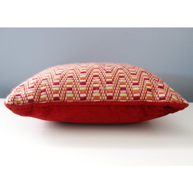 Lovely handmade vintage needlepoint pillow. Unique zig zag pattern in deep red, orange, pink, and light green. Solid red...