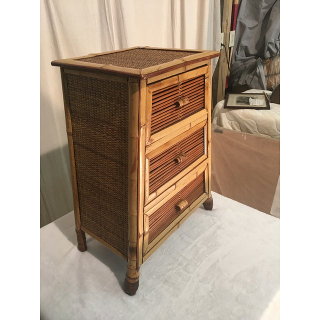 "This pretty little nightstand is wider at the bottom (18"") and narrows at the top (13""). It has 3 drawers. Would bring a..."