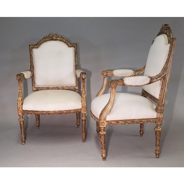 Gold Leaf, reeded arm rests. Nicely carved floral crown, heavily carved all over, painted with gilt accents, spiral turned...