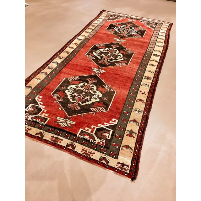 Vintage Turkish Sivas gallery size rug, wide and long. An uncommon size. Three dramatic medallions on a brick red field...