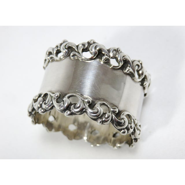 This is a very nice quality American Victorian sterling silver napkin ring. The piece was made by the Towle Silver...