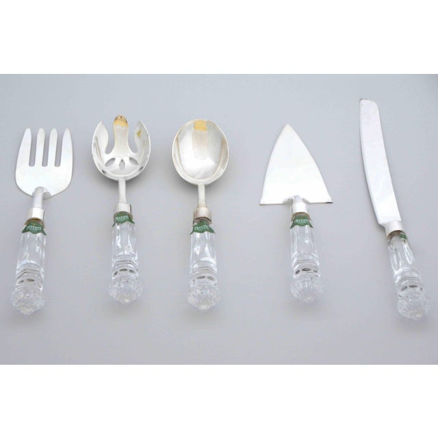 Elegant Crystal and Silver utensils set of 5. Set includes: 1 pastry server 1 cake knife 1 serving spoon 1 open spoon 1...