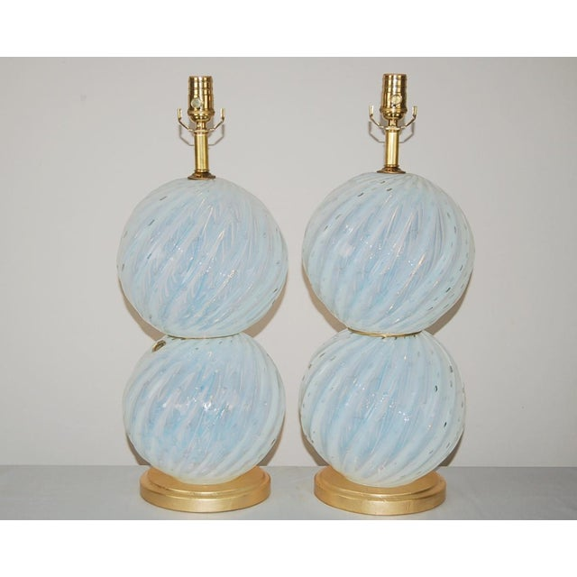 A pair of vintage WHITE OPALINE Murano glass ball table lamps. The Opaline gives the glass a magical aura – the glass...
