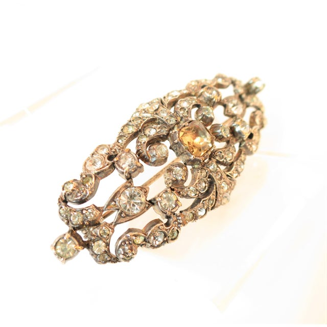 Offered here is an Edwardian hand-fashioned sterling silver brooch set with French paste stones, Circa 1905. Within the...