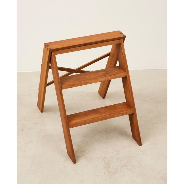 A handsome folding step ladder in teak with elegant joinery. Denmark, 1940s.