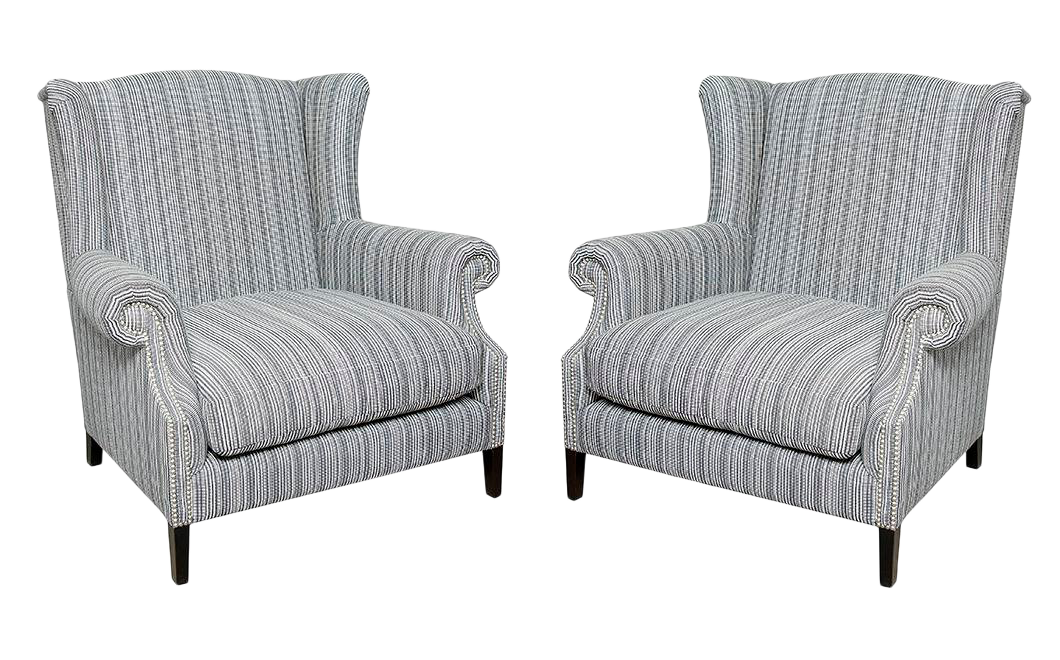 Pair Of Studded Wingback Chairs