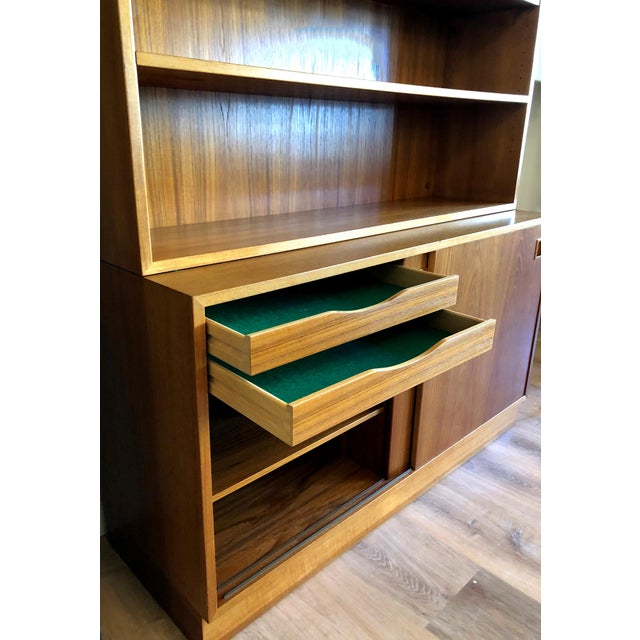 Beautiful condition. Felt-lined drawers and dovetail construction. Adjustable / removable modular shelving unit rests atop...