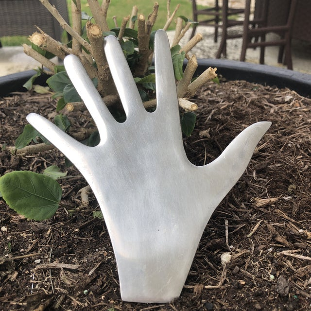 "Whimsical life sized cast aluminum Human hand shaped trivet. Has 4 solid feet built in making it stand about 1/2"" off the..."