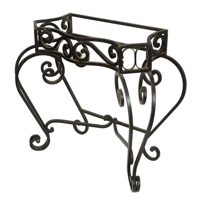 A pair of heavy outdoor iron console bases. Tops are not included.