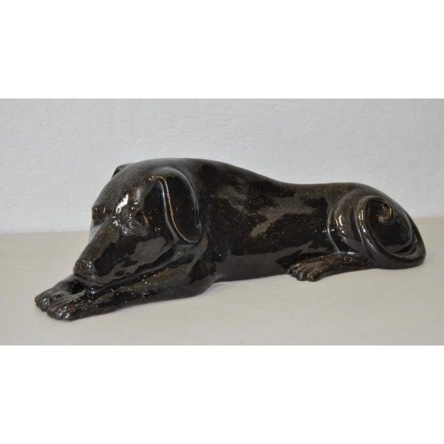Early 20th Century glazed ceramic reclining dog, Circa 1920. Fantastic first quarter of the 20th century glazed ceramic /...