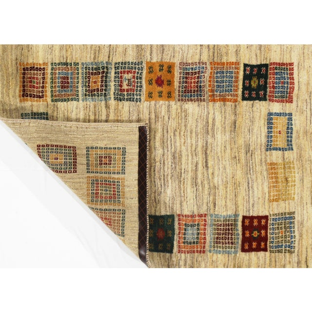 This is a gorgeous Persian Gabbeh rug. The piece was hand-knotted from hand-spun fine lamb's wool. The rug has a dense,...