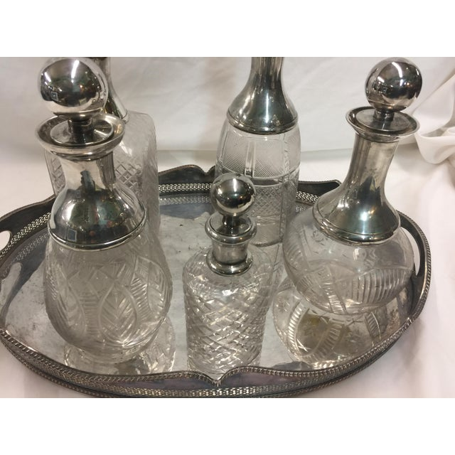 Stunning Antique Silver plate tray with 20th Century cut crystal licquor decanters. The bottles are in excellent...