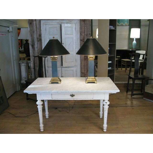 A very handsome pair of 1970s lamps with Brass column bases and lacquered centre columns. Beautiful design and scale, with...