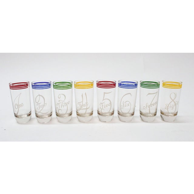 Set of 8 vintage number glasses. Each glass with the digit in the foreground with a colorful rim. The bright retro colors...