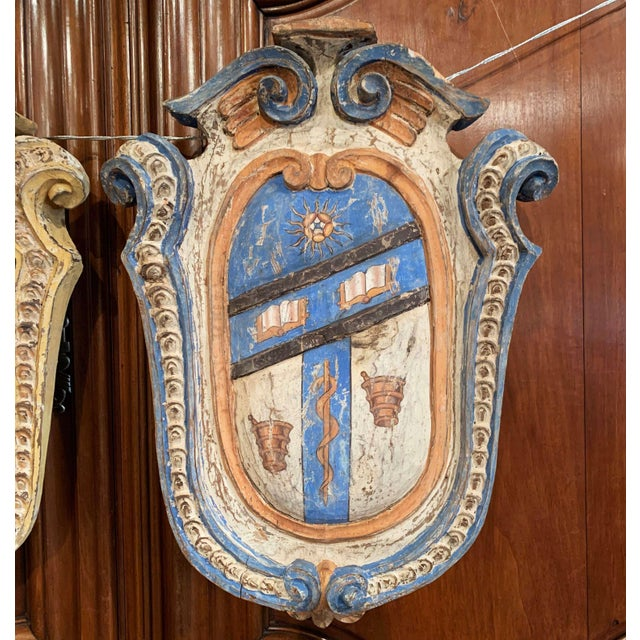Embellish your study or library with this colorful pair of antique shields. Hand carved in France, circa 1920, each...