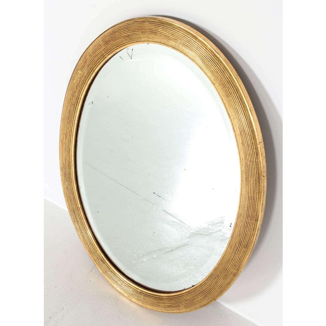 Elegant late 19th-early 20th century mirror with original mirror and recently restored gold leaf frame.
