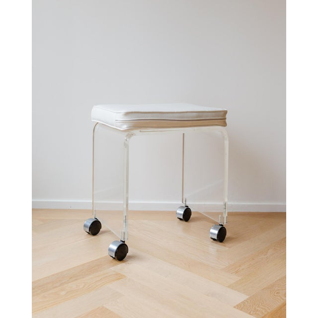 """17"""" Length X 12"""" Width X 19"""" Height Mid-Century Modern Lucite stool with a white faux leather padded eat on chrome..."""
