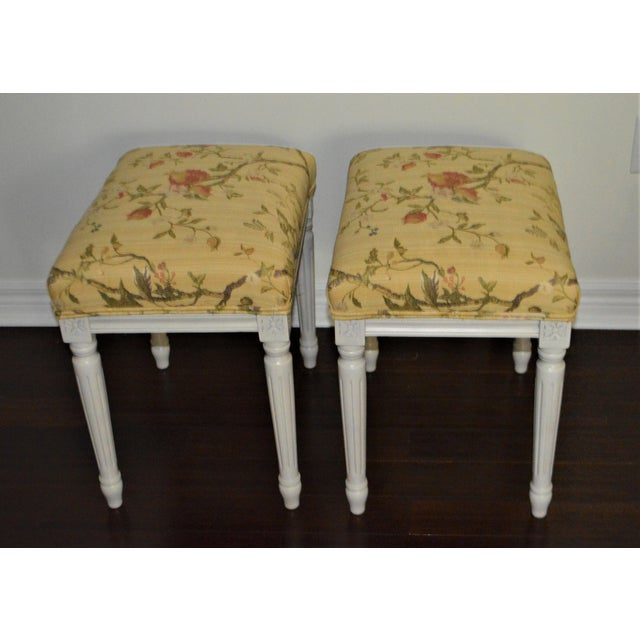 Pair of charming Gustavian style benches, painted in a light grey and newly upholstered in a cheerful yellow print Italian...