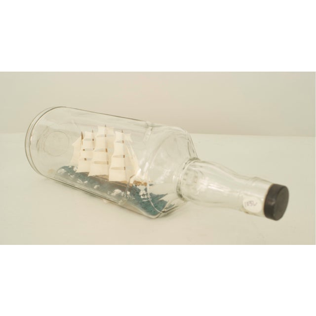 American/English (20th Cent) sailing ship with 4 masts in a ½ round and 3 sided glass bottle