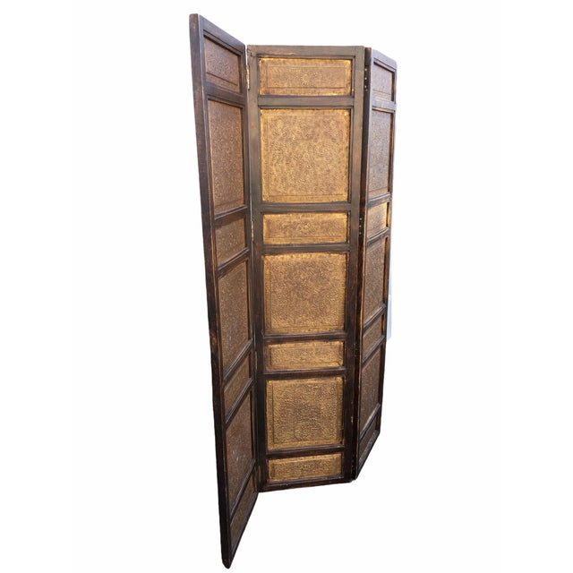 Beautiful middle eastern room divider c. 1940s. Israeli in origin, features a dark stained wooden frame with sheets of...