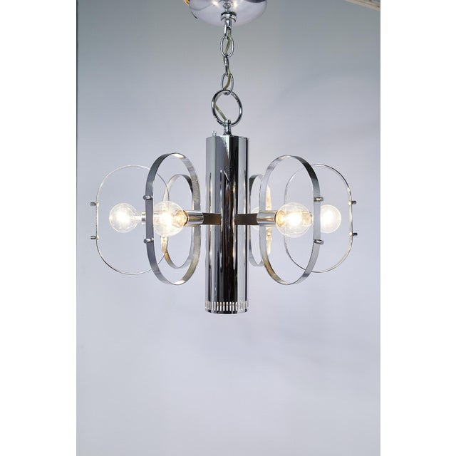 Great quality midcentury light fixture by Forecast Lighting having a tubular pendant with hidden downward facing light and...