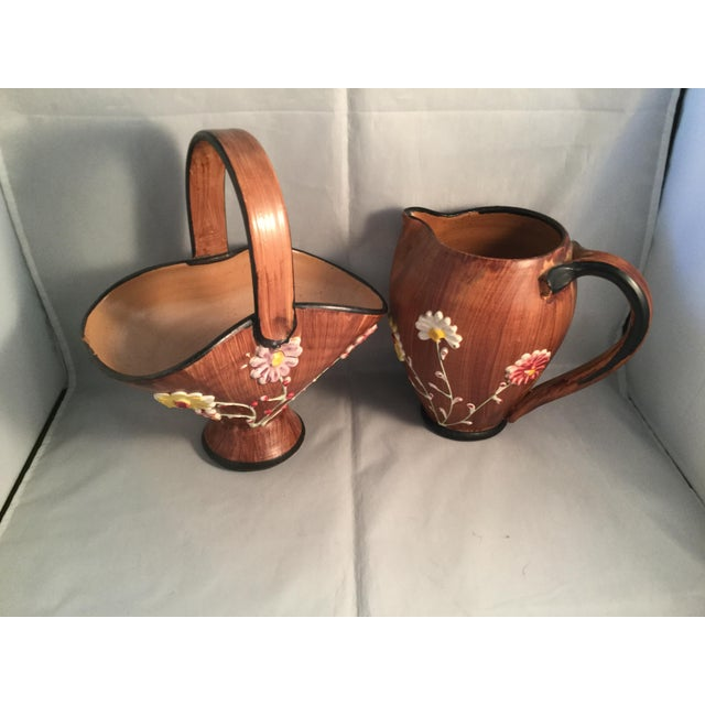 Brown ceramic pitcher and basket. Handmade in Italy.