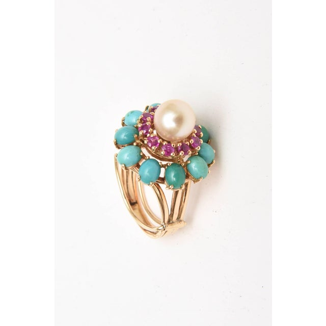 This lovely dome cocktail ring of 14K yellow gold has 10 oval cabochon cut turquoise stones prong set that are preceded by...