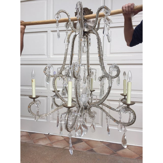 Lovely Dennis & Leen chandelier that will be beautiful in any setting - traditional, modern, even on a covered patio!