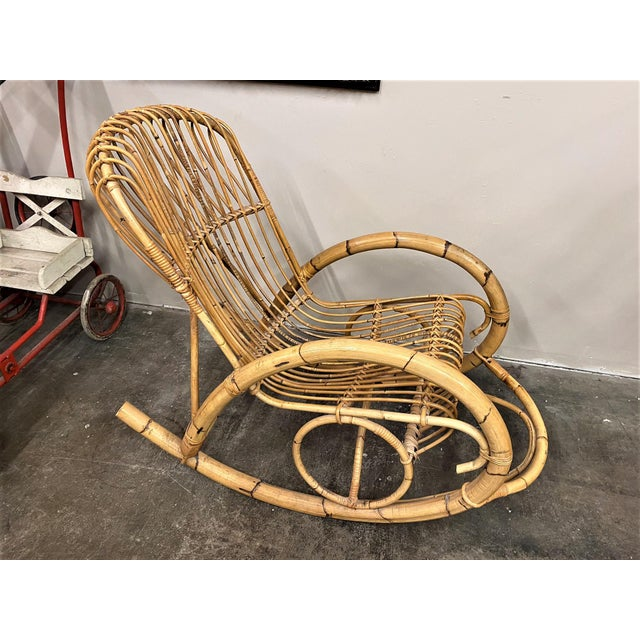 Authentic 1960s Franco Albini rattan style rocking chair.Has a removable green velvet cushion that attaches with ties. In...