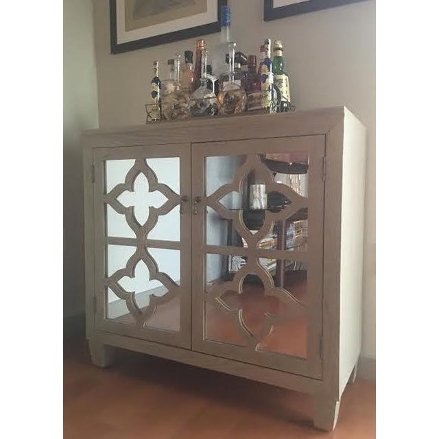 Beautiful mirrored bar cabinet with a lot of storage. Inside of cabinet has a built in wine rack that fits 13 bottles,...