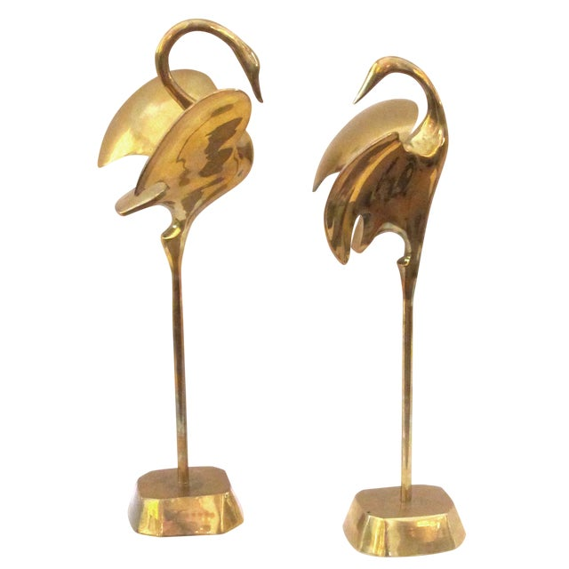 A Graceful Pair of Stylized Solid Brass Cranes For Sale