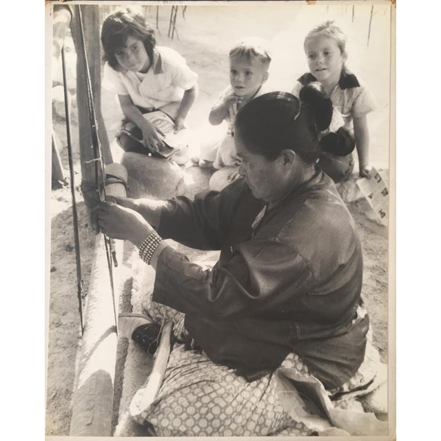 Original vintage photograph of a Navajo weaver by Ruth McNitt. Signed on verso. Unframed. Photo in great condition but...