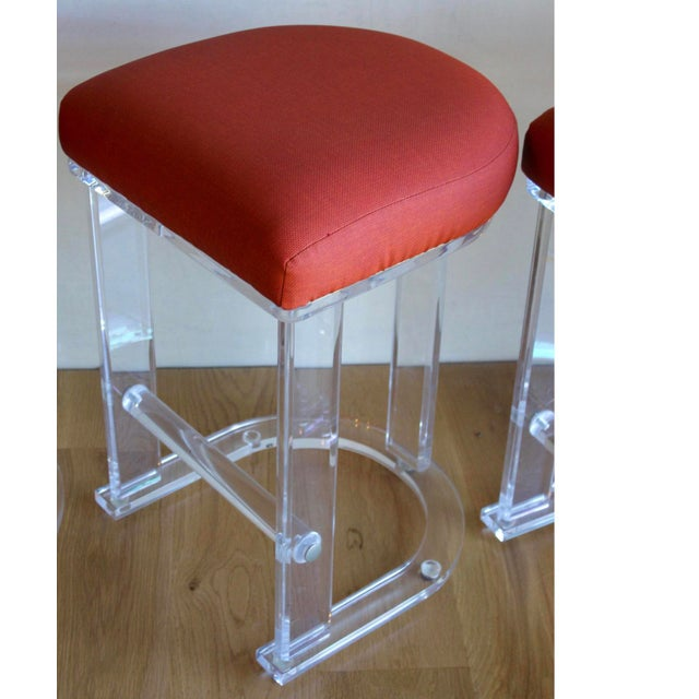 Pair of Mid Century, super substantial, thick Lucite counter stools with horseshoe bases and thick, rod Lucite foot rests....
