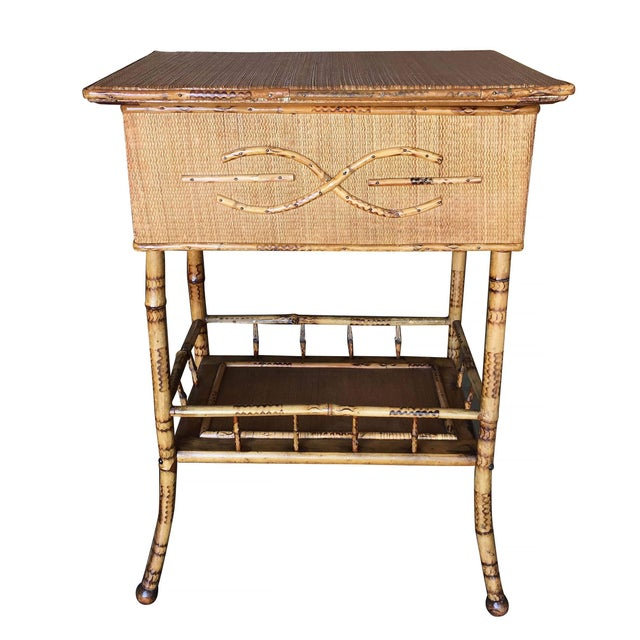 Antique tiger bamboo pedestal side table with rice mat top with flip open lid storage and a secondary bottom shelf....