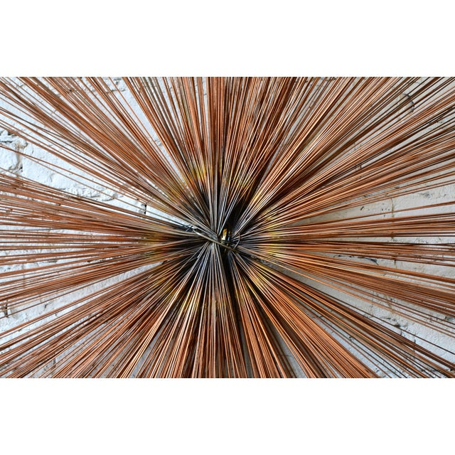 Starburst wall sculpture. Unlike its Curtis Jere starburst counterparts, this piece is comprised of multiple concentric...
