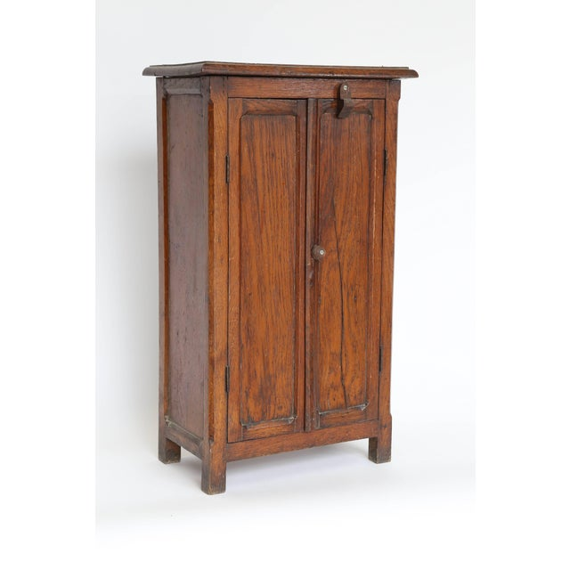 A marvelous antique model armoire, circa 1890, found in France. With two removable interior shelves, rich color and...