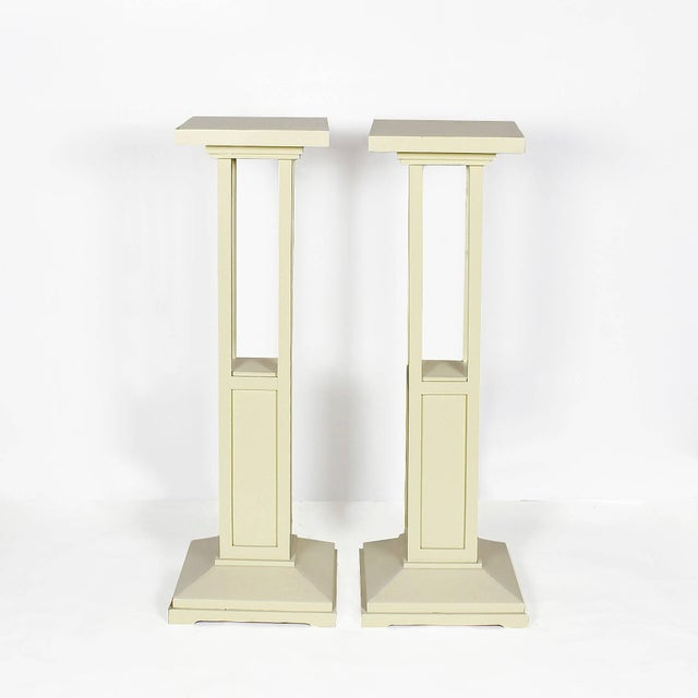 Pair of Cubist Art Nouveau stands, ivory lacquered oak wood. France c. 1910