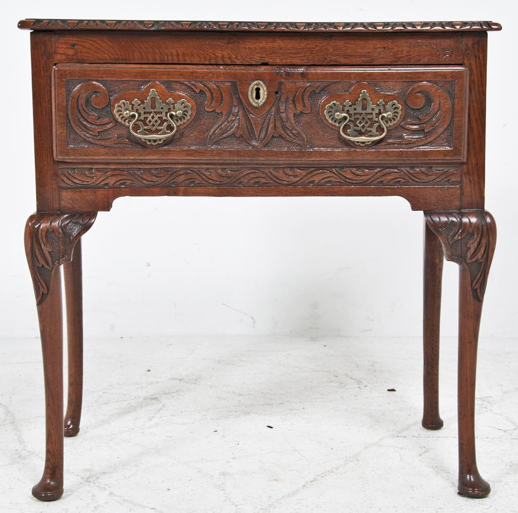 An 18th Century Scottish Chestnut One Drawer Table. The Drawer Is Carved  Along With The