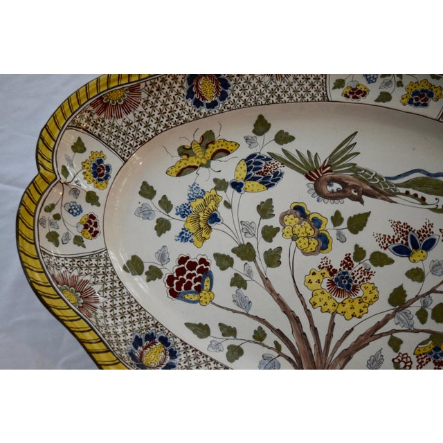Faience platter. Unsure of exact age. In great condition. Some natural defects to crazing on back of platter. This has...