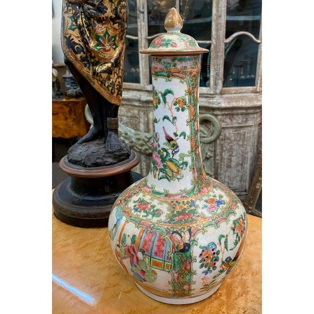 Lidded 19th century Rose Medallion bottle vase.