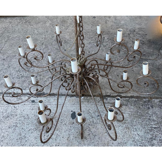 French wrought iron chandelier scrolling arm. Total of 20 lights. Maker unknown.