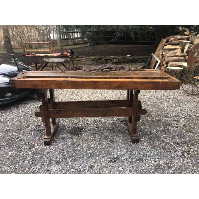 Perfect as a display piece or handsome console or bar, this is a one of a kind very large masculine oak work bench from...