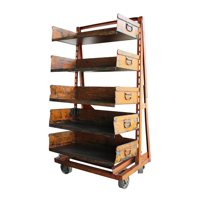 The ultimate industrial storage option! This a-frame rolling industrial cart has 5 adjustable shelves and a well-worn coat...