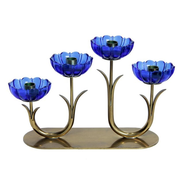 Add a touch of Swedish design to your tabletop with this beautiful mid-century brass and glass candelabra designed by...