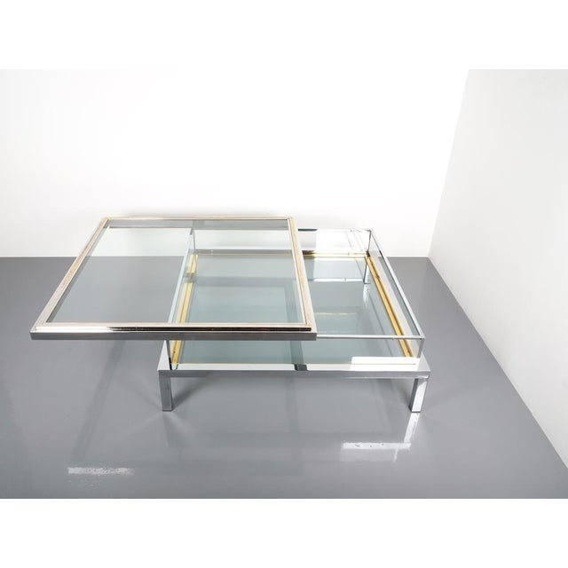 """Refurbished Large Maison Jansen Brass and Chrome Vitrine Coffee Table, 1970. 42.5"""" elegant 1970s French chrome and glass..."""