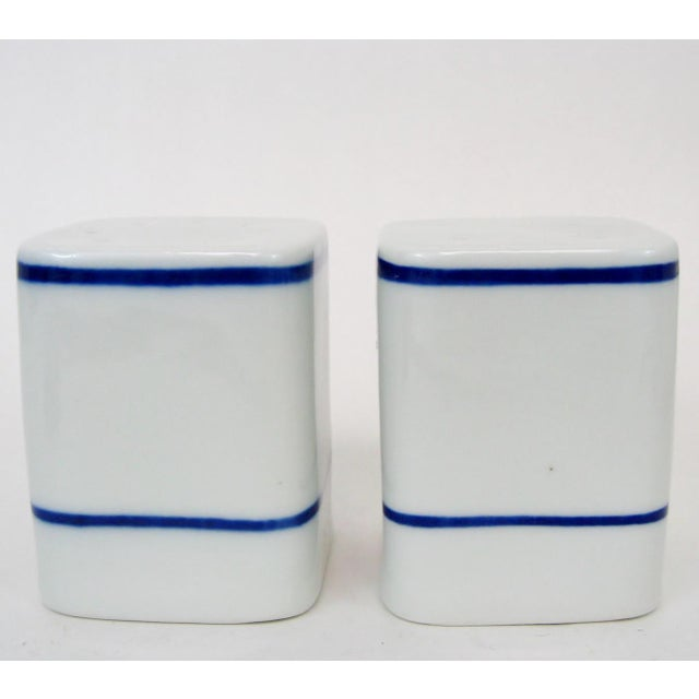 Large Portuguese country-style white porcelain salt & pepper shakers in a square shape with hand-painted blue accents....