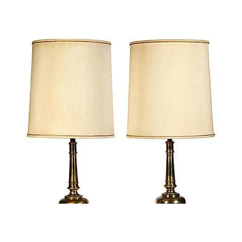 Pair of brass table lamps designed by Stiffel, circa 1960s. Wired for the US and in working condition. Uses 100W bulbs....