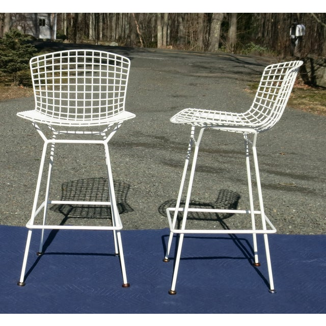 """Pair of Knoll Bertoia Barstools signed Knoll on back bar. They are 41"""" high x 21"""" wide and approx. 23"""" deep. The seat..."""