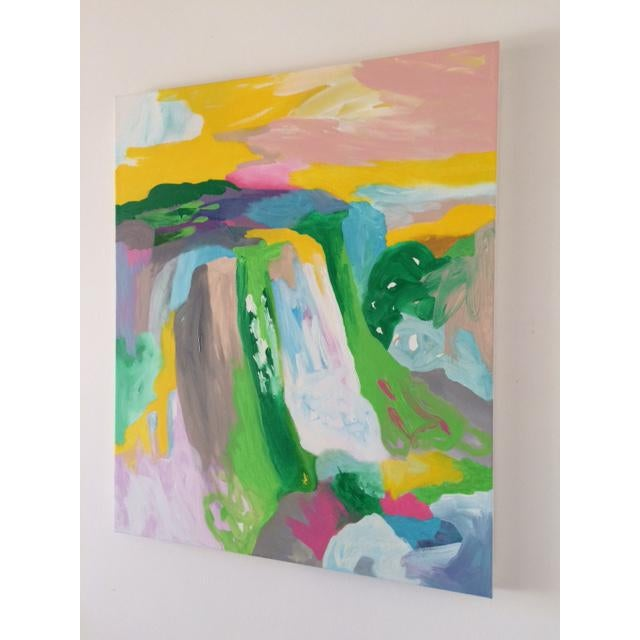 A playful landscape mixed-media painting of an imagined waterfall, rendered with a bold and vibrant color palette.