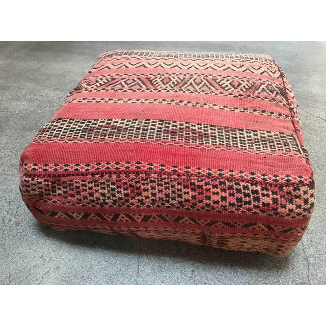 Moroccan vintage floor pillow seat cushion made from a Tribal Berber rug. Square shape with nice faded earth tone colors...